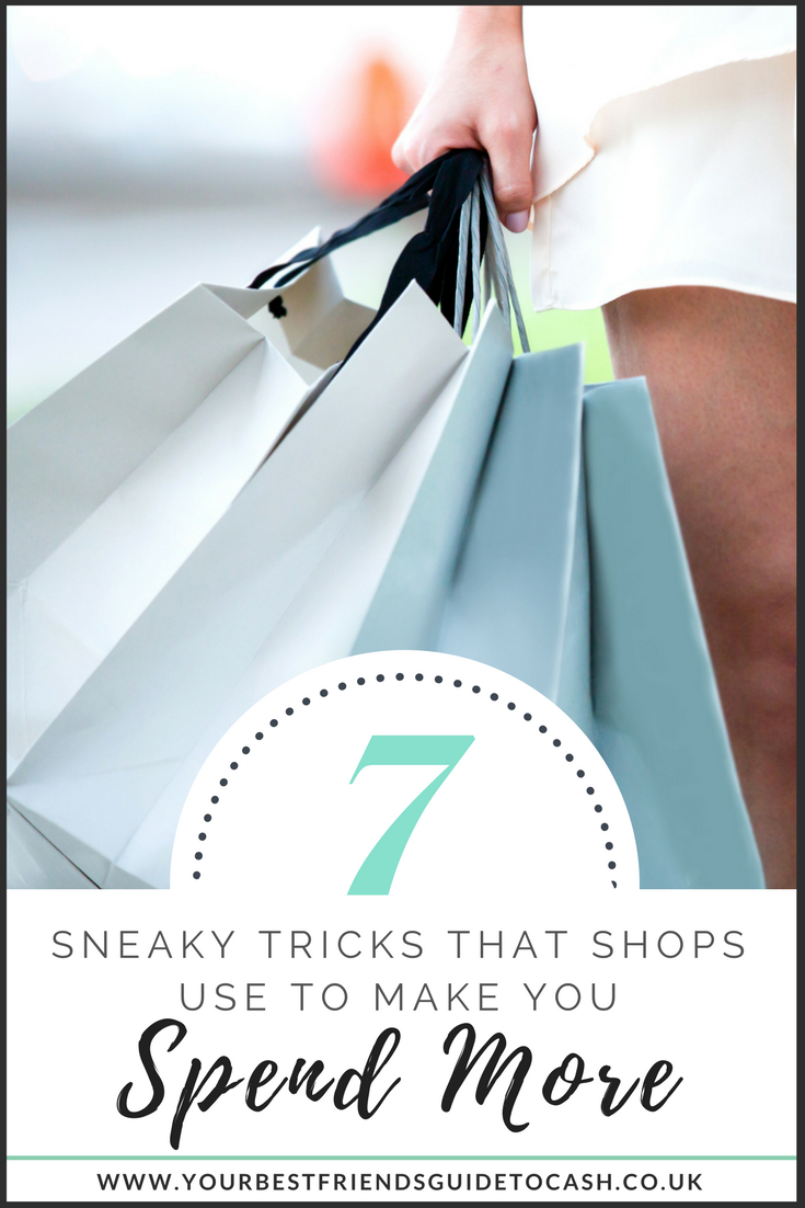 Seven sneaky tricks that shops use to make you spend more - woman holding blue shopping bags