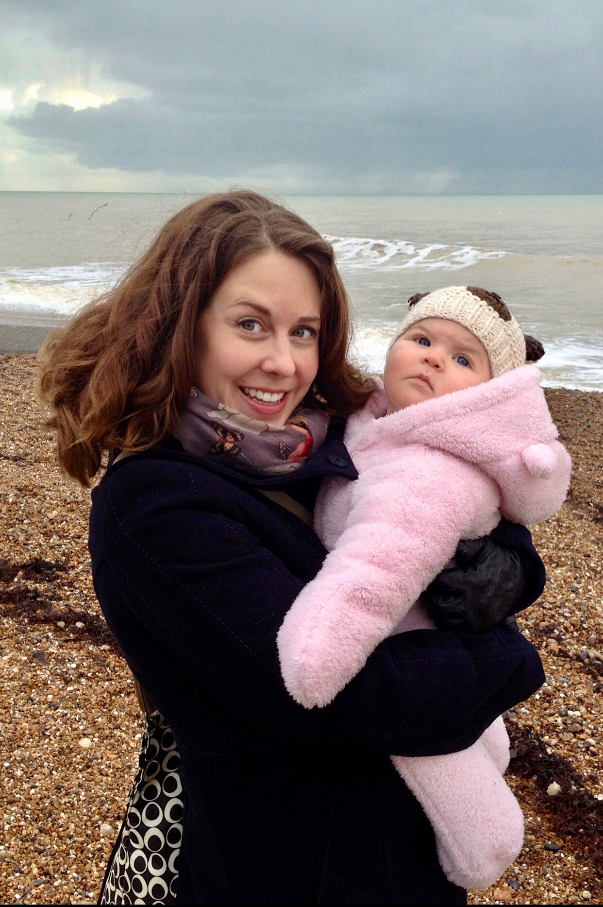 Kara Gammell and her daughter on a beach