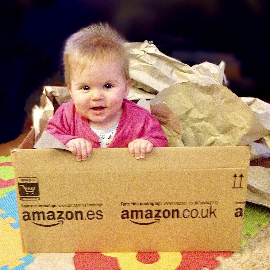 A baby in an Amazon box